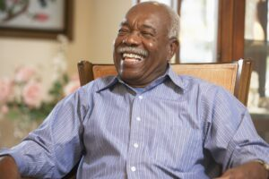 Senior man relaxing in armchair and laughing